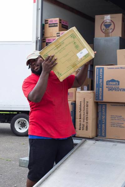 Antwan D managing a moving project and unloading a moving truck